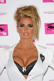 Katie Price added some ultra lengthy lashes to her makeup look at a promotion of her new series 'Signed By Katie Price'.