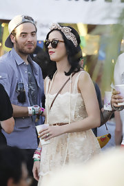Katy Perry wrapped a blush polka dotted scarf around her head and tied it in the shape of a bow.