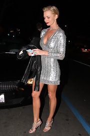 Jaime's Grecian stilettos perfectly match her sparkling Farah Khan mini dress.