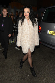 Katy Perry stepped out in London looking edgy-glam in black motorcycle boots and a pink fur coat.