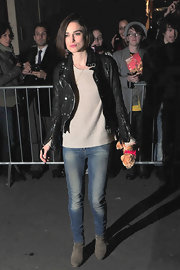 Keira looks rocker chic in a black leather jacket with faded blue jeans outside of her show in London.