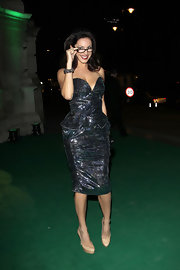 Kelly Brook looks divine in nude platform pumps. Her sexy secretary glasses complete the sassy look.