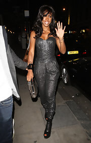 Kelly Rowland showed off her cool metallic jumpsuit while hitting the Whisky Mist in London.