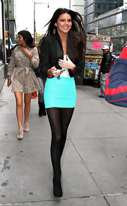 Kendall Jenner wore her ultra-mini aqua skirt with opaque tights while out in NYC.
