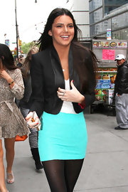 Kendall Jenner kept warm in this cropped blazer with leather trim while rocking a miniskirt in NYC.