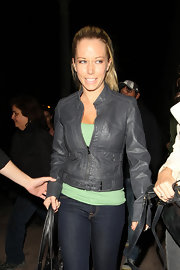 Kendra dons a light leather jacket while out in LA. She pairs this casual look with jeans and a leather tote.