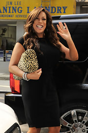 Wendy Williams paired her cap-sleeve dress with long wavy locks.