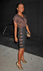 Genevieve Jones looked chic in a brown and black fitted dress with lace slits up the side at the CFDA Fashion Awards 2012.