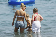 British singer Kerry Katona has her the names of her two daughters and her ex-husband inked to her upper back.