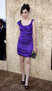 Sasha stood out in a ruched jewel-tone cocktail dress with peep toe pumps.