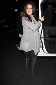 Khloe Kardashian went out to dinner in olive green over-the-knee lace up boots.