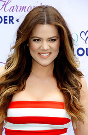 Khloe Kardashian chose a soft nude lip that had a playful orange tint, perfect for summer!