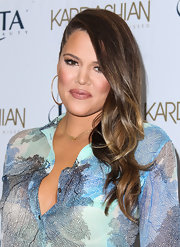 Khloe Kardashian looked very feminine wearing her wavy locks in a side sweep while promoting the new Kardashian Sun Kissed line.