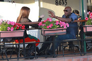 Lamar Odom grabs a bite to eat with his girlfriend Khloe Kardashian while wearing a cool new pair of sunglasses.