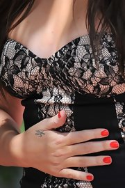 Bright red nails provided a pretty pop against Khloe's lacy black dress.