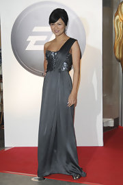 Karen is radiant in a gunmetal one-shoulder gown in London.