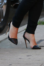 Kim Kardashian opted for a black classic heel for her daytime look.