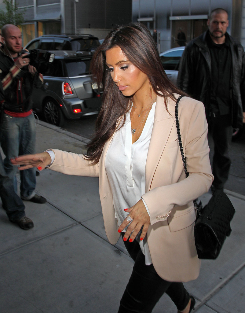 Kim Kardashian Wore Her Nails Painted A Bright Orange Red Shade While Heading For Nail Polish