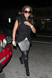 La La Anthony looked snug and stylish in a black knit top during a night out at Nobu.