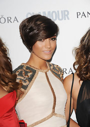 Frankie Sandford wore her shiny chocolate tresses side-parted and piecey.