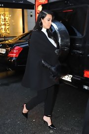 Kim Kardashian strolled around Paris in a pair of pointy black ankle-strap pumps.