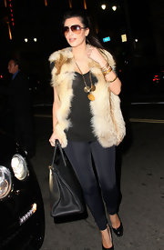 She wears her sunglasses at night! The always glamorous Kim, tries to keep a low profile while exiting the popular restaurant Katsuya.