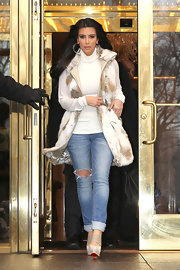 Kim Kardashian balanced the glamorous vibe of her fur vest with a pair of tight ripped jeans.