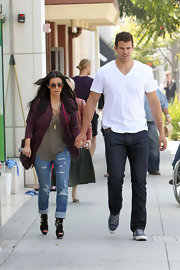 Kris Humphries was out and about in a white tee paired with dark jeans and casual sneakers.