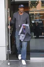 Lamar Odom showed off his trim physique in a tight gray Henley while out and about in NYC.