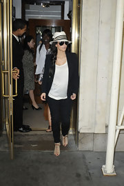 Kim K accessorized her casual chic outfit with laceup booties and a beige fedora.