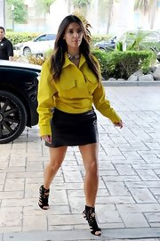 Kim's bright hybrid top was one part button-down, one part jacket, and every part stylish.