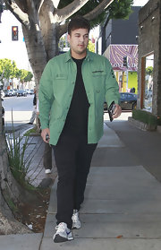 Rob Kardashain chose an army-green, utility-style button down for his daytime look.