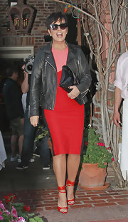 Kris Jenner chose a black, pink, and red fitted-cocktail dress for her look while out dining with her family.