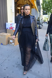 Kim Kardashian chose a flowing black maxi dress for her look while out and about in NYC.