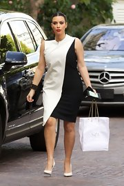Kim Kardashian joined the black-and-white trend in this artistically asymmetrical dress while out in Beverly Hills.