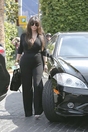 Kim Kardashian chose a black jumpsuit for her look while grabbing lunch in LA.