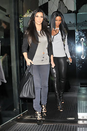 "Kim showed off her coveted ""Birkin"" bag while out with friend Ciara."