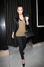 Kim Kardashian carried a black quilted Chanel flap bag while meeting friends for dinner.