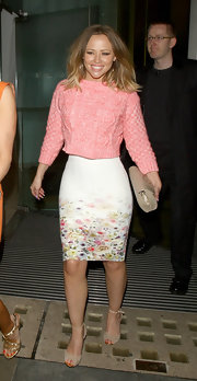 Kimberley Walsh looked darling in a floral pencil skirt paired with a cable-knit sweater during a night out in London.