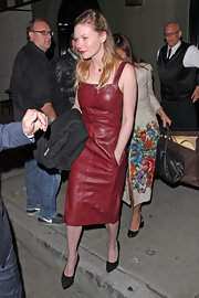Kirsten rocked an oxblood leather dress while out in Hollywood.