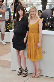 A pregnant Charlotte Gainsbourg teamed her black shirtdress with strappy multicolored platform sandals.