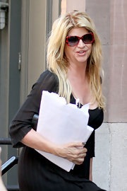 Kirstie Alley accessorized with a fun pair of red-framed butterfly sunglasses white out and about in New York City.