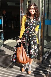 Myleene paired her 40's inspired floral dress with tan suede t-strap heels and a cognac purse. Retro curls complete the stunning look.