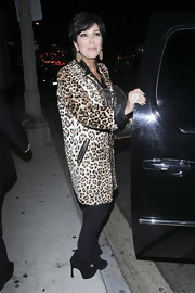 Kris Jenner showed where her daughters get their love of animal prints from in a long leopard print jacket with zipper details.