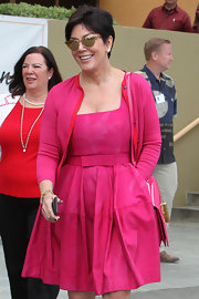 Kris Jenner was pretty in pink with this fuchsia frock with a belted waist and bow accent.