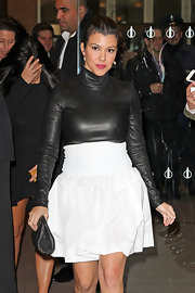 This may look like a leather turtleneck, but actually it's a full on bodysuit under this white voluminous skirt.