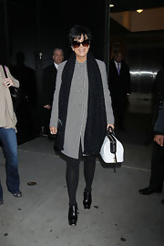 Kris Jenner was chic in black and white for her appearance on 'Good Morning America.' The reality starlet topped off her look with black leather ankle boots.