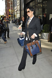 Kris Jenner looked sophisticated in a sleek pinstripe suit and playful leopard print tie.