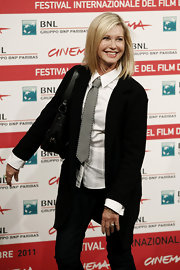 Olivia Newton-John opted for a boyish style atthe Rome Film Festival in a crisp white shirt, gray tie and a black blazer.