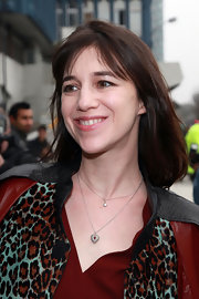 Charlotte Gainsbourg attended Paris fashion week wearing her hair in a sleek bob with wispy lash-length bangs.